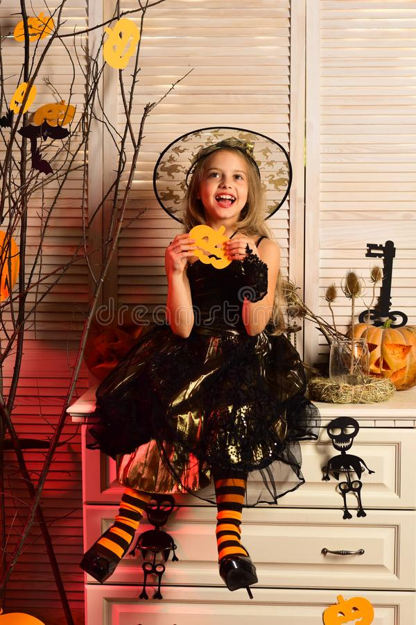 Happy little girl enjoy halloween. Little girl wear witch costume on halloween. I witch you a happy halloween. Haunting. Beauty stock image
