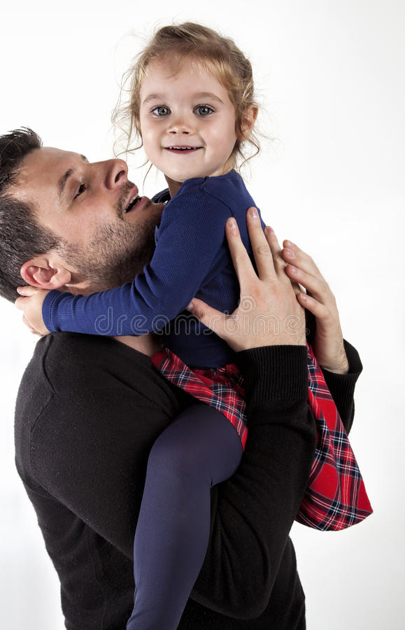 Happy little girl with father stock image