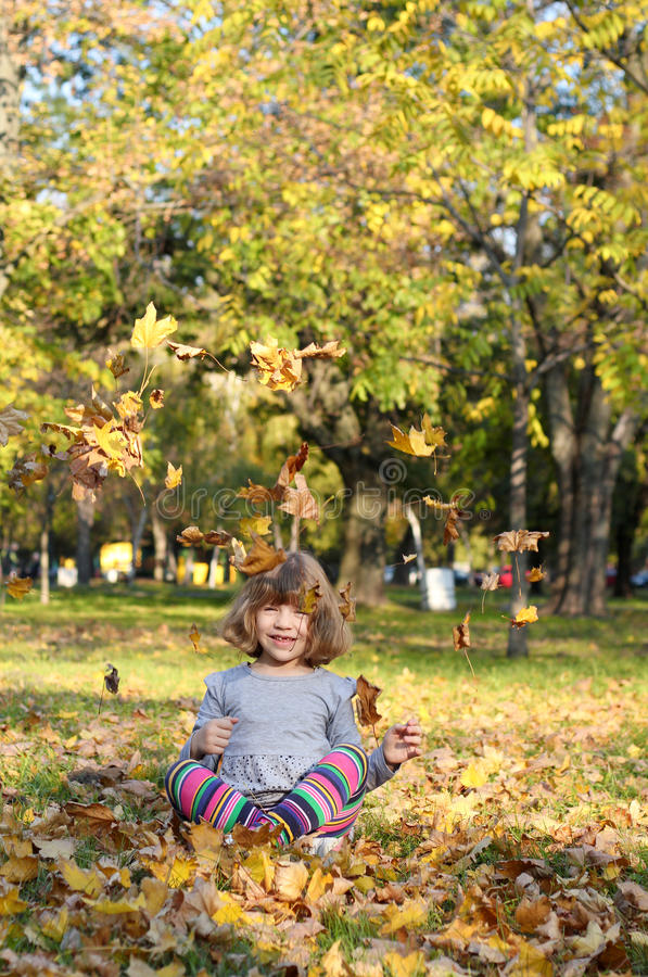 Download Happy Little Girl Fun With Autumn Leaves Stock Image - Image of sweet, fall: 27436065