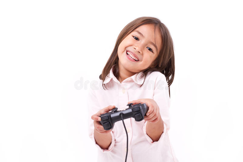Happy little girl gamer playing video game royalty free stock photo