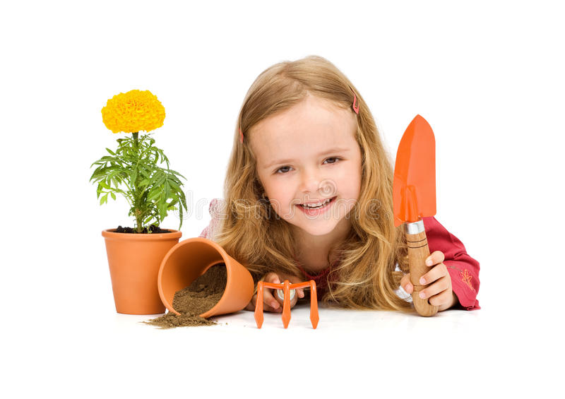 Happy little girl with gardening utensils stock images