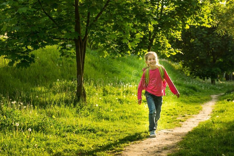 Happy little girl go to school stock image