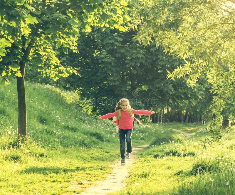Happy little girl go to school stock photos