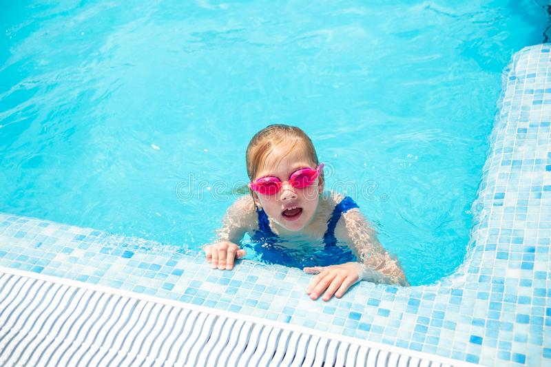 Happy little girl in goggles playing in swimming pool Beach resort, summer vacation, travel and tourism concept. Relax royalty free stock photos