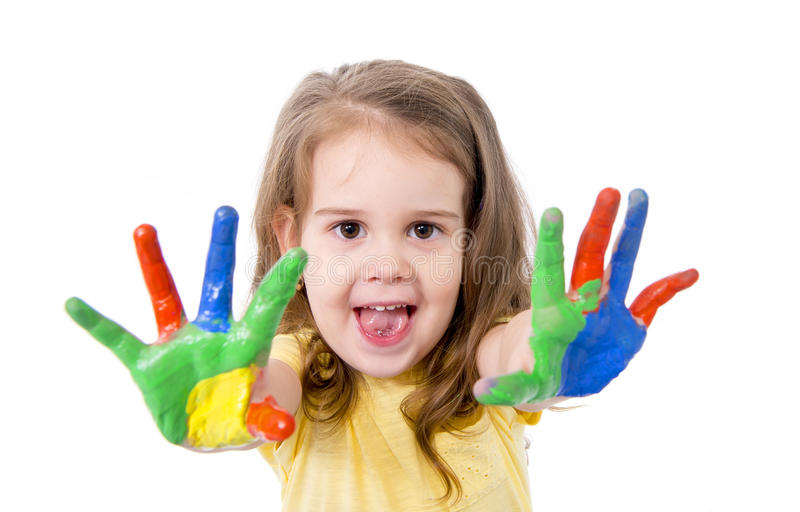 Happy little girl with hands painted in color royalty free stock images