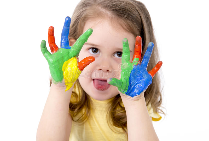 Happy little girl with hands painted in color royalty free stock photo