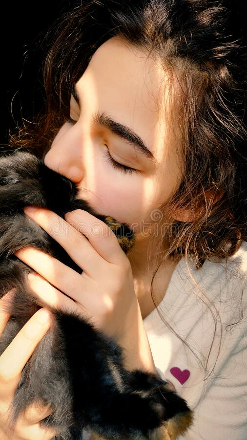 Little girl with black bunny stock photo