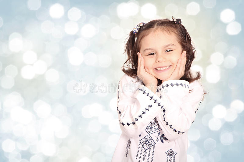 Happy little girl with her sheep toy - celebrating Eid ul Adha -. Happy little girl playing with her sheep toy - celebrating Eid ul Adha - Happy Sacrifice Feast stock image