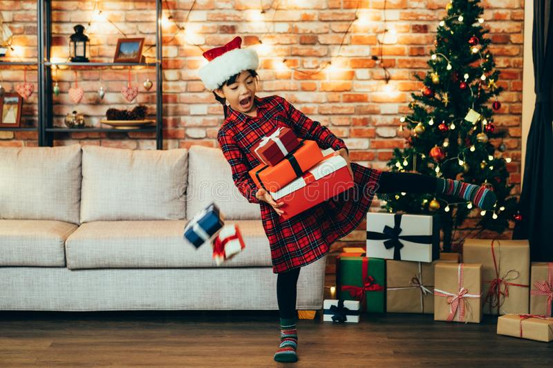 Happy little girl holding many christmas gifts royalty free stock images