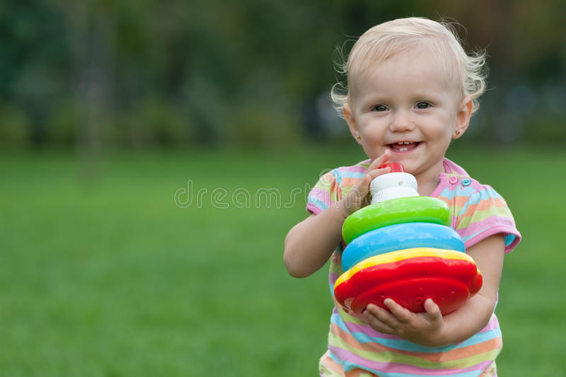 Download Happy Little Girl Holding A Toy Pyramid Stock Image - Image: 16412361