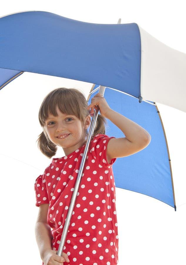Happy little girl holding umbrella stock photography