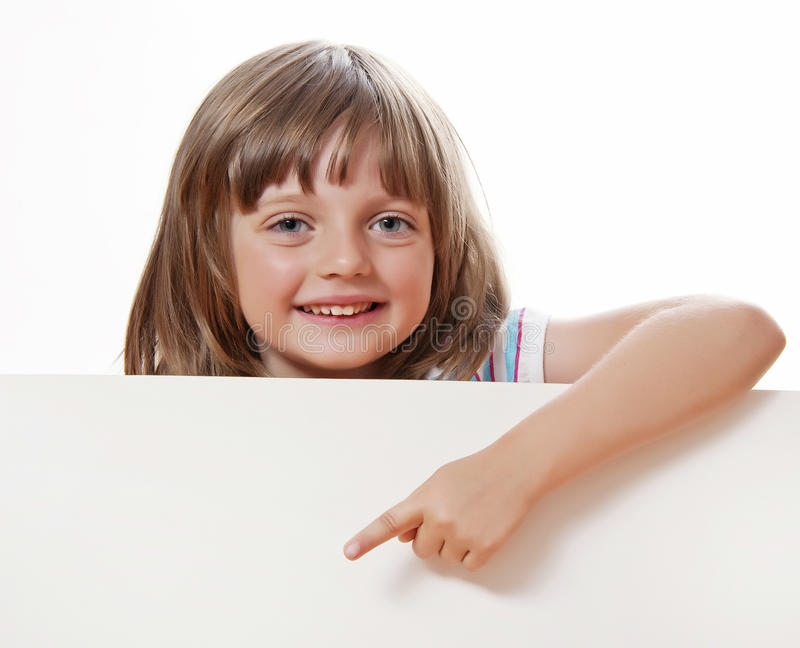 Happy little girl holding white board stock image