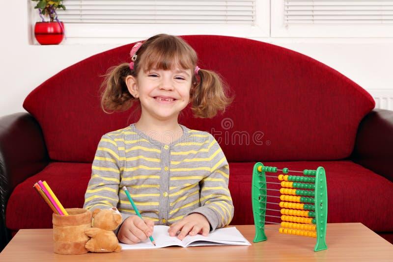 Download Happy little girl homework stock photo. Image of girl - 28675160