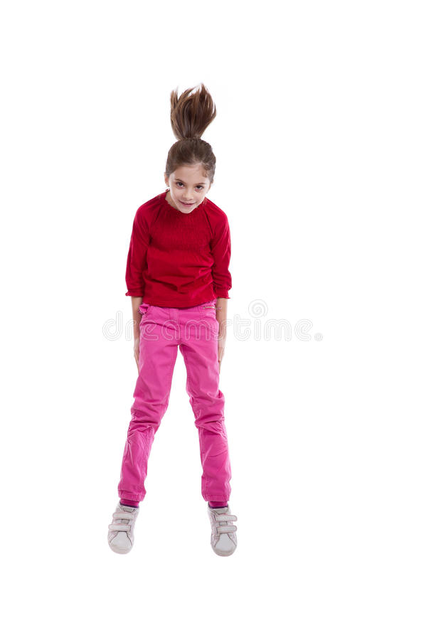 Happy little girl jumping stock image