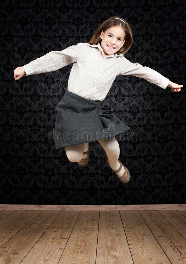 Download Happy little girl jumping stock image. Image of person - 22682059