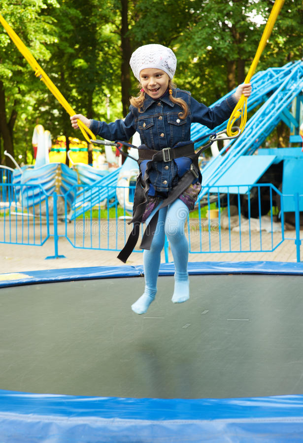 Happy Little Girl Jumping On Stock Photo