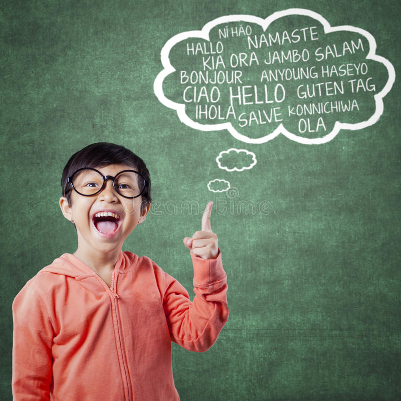 Happy little girl learn multi language stock images