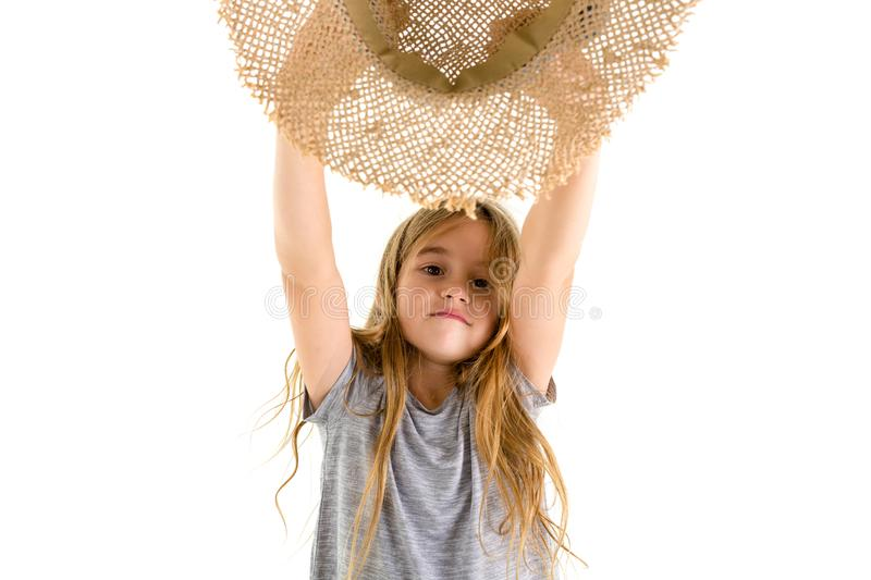 Happy little girl cheering and waving her hat stock photography