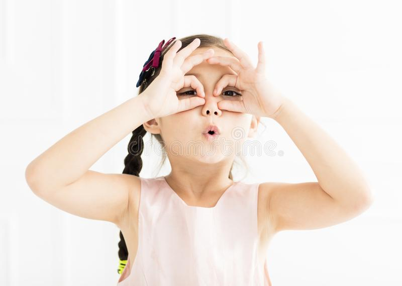 Happy little girl looking far. Isolated royalty free stock images