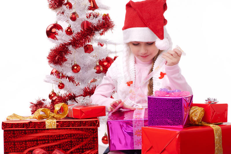 Happy little girl with many Christmas present stock image