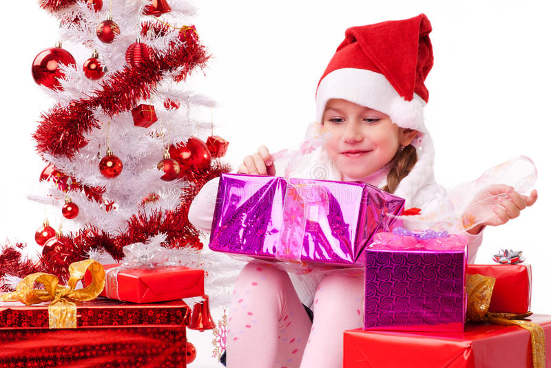 Happy little girl with many Christmas present stock images