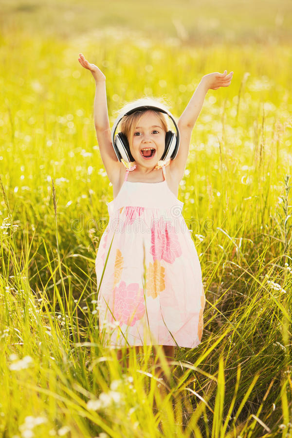 Happy little girl on nature royalty free stock photo