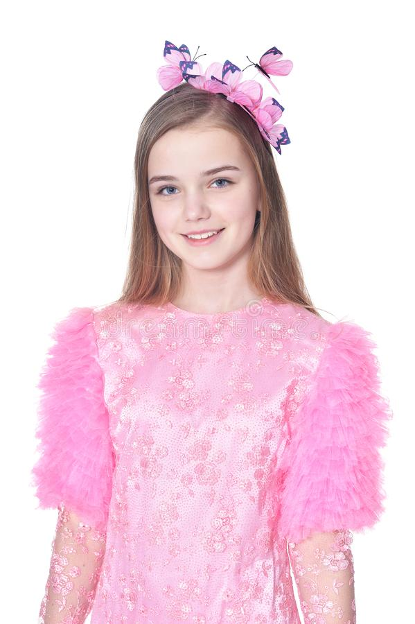 Happy little girl in pink carnival costume posing stock images