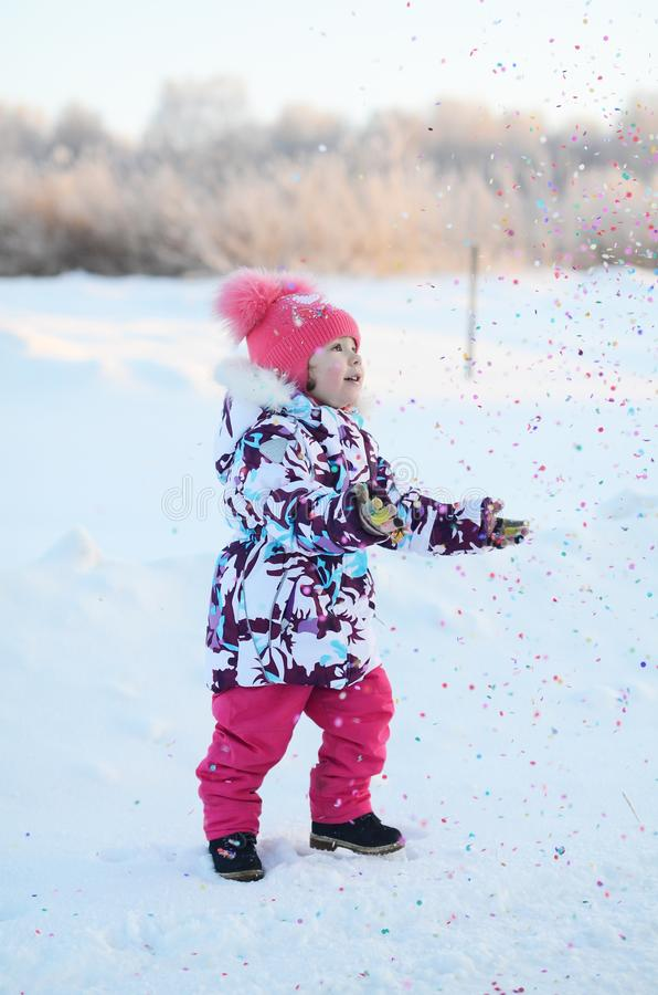 Happy little girl with confetti stock photos