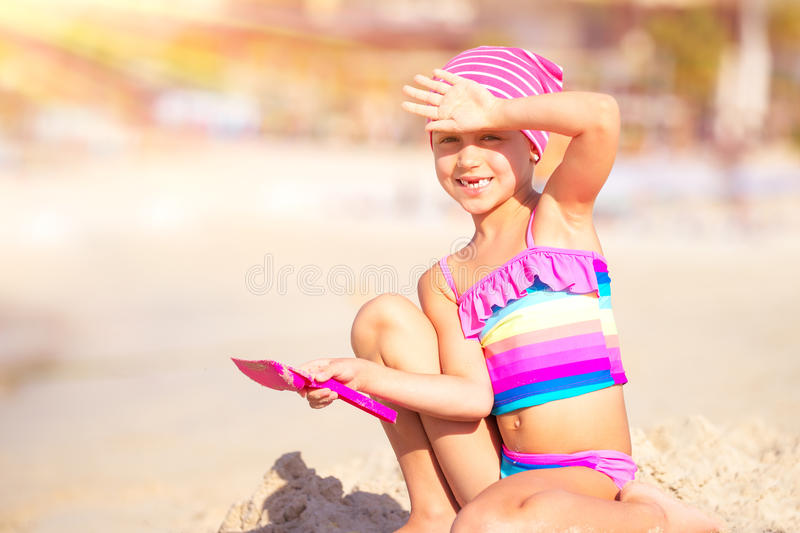 Happy little girl playing on the beach stock image