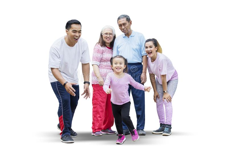 Happy little girl playing with her family on studio royalty free stock image