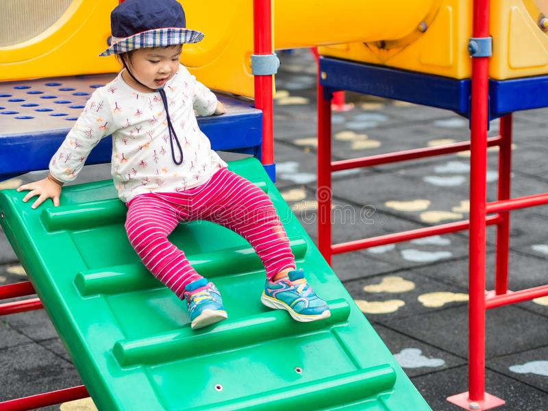 Happy little girl playing at the playground. Children, Happy, Fa royalty free stock photography