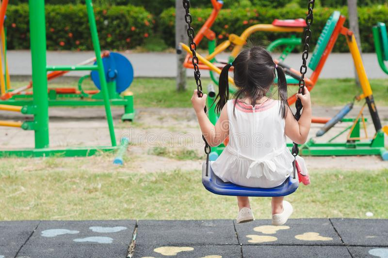 Happy little girl playing swing at the playground. Happy, Family royalty free stock images
