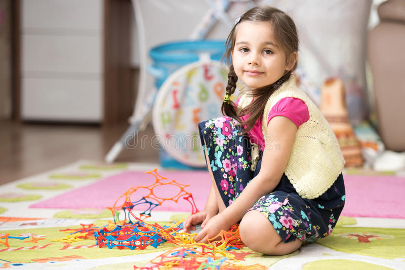 Happy Little Girl Playing With Toys At Home stock photography