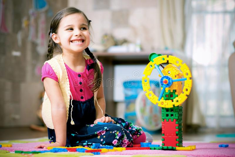Happy Little Girl Playing With Toys At Home royalty free stock photos