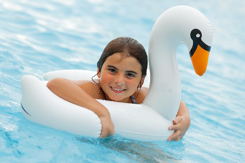 Happy Little Girl in the Pool royalty free stock image