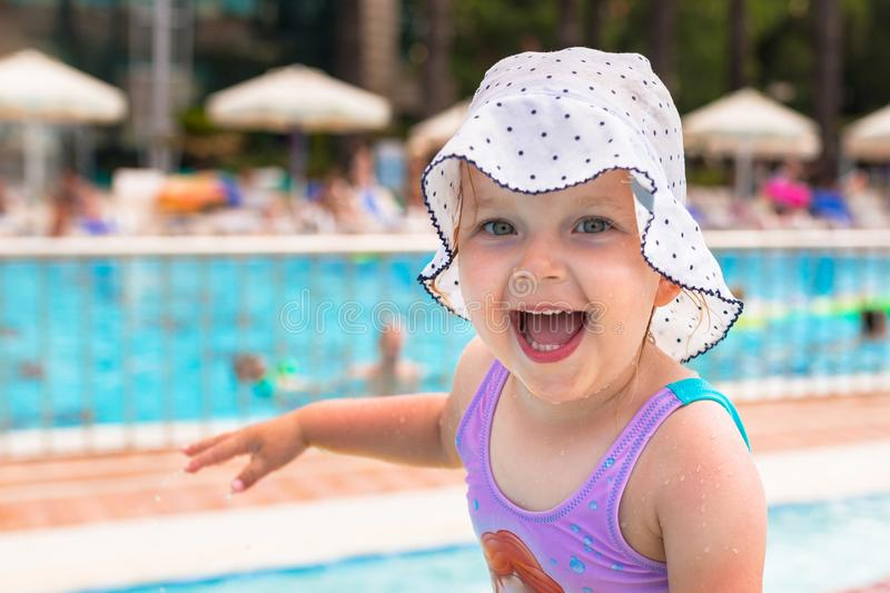 Happy little girl portrait at the pool stock photo