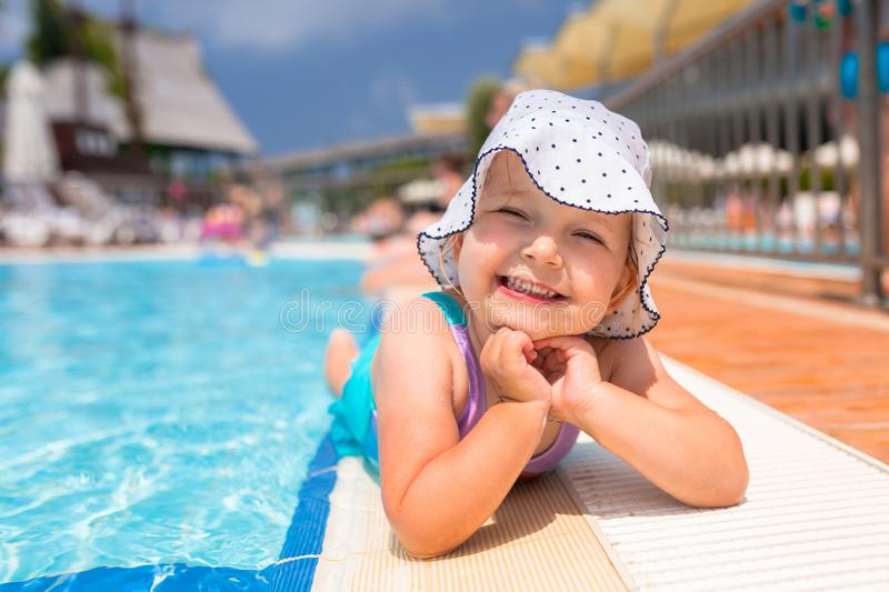 Happy little girl portrait at the pool stock photography