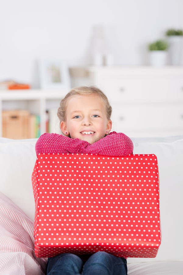 Happy little girl with present royalty free stock photography