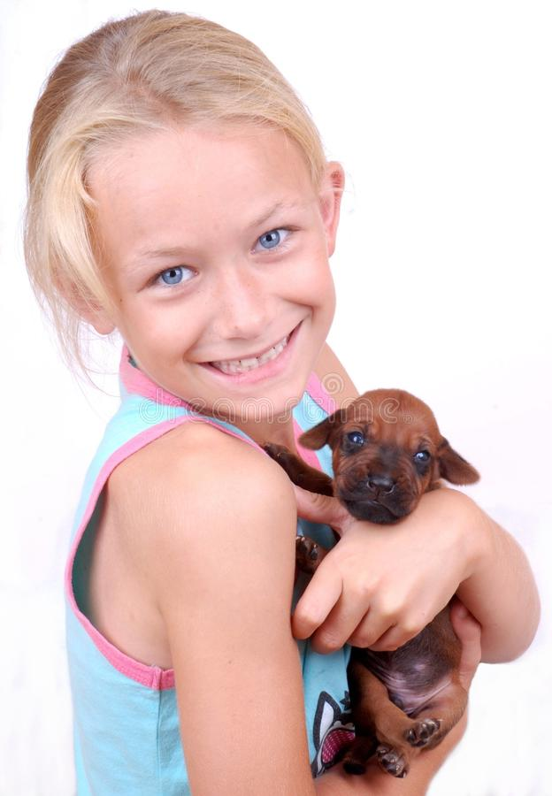 Happy little girl with puppy