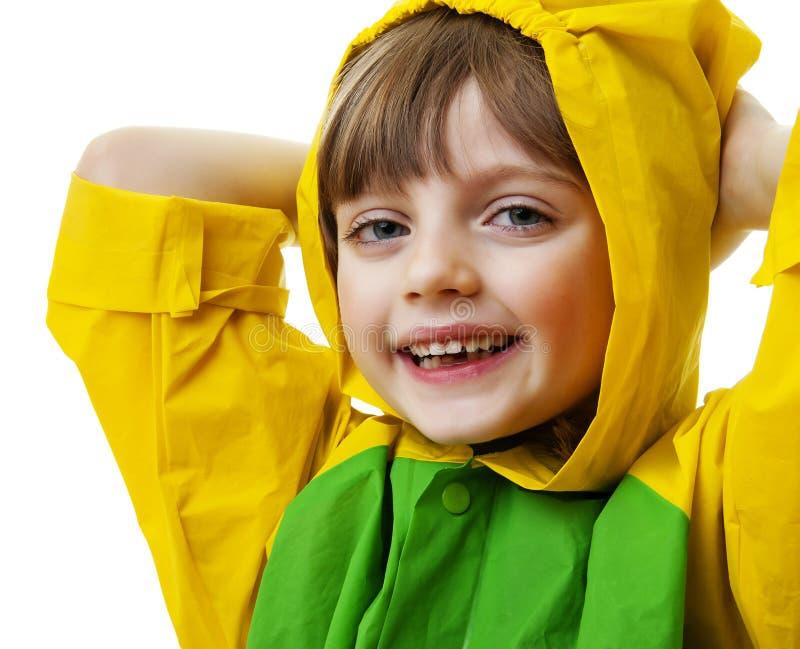 Happy little girl with raincoat stock image