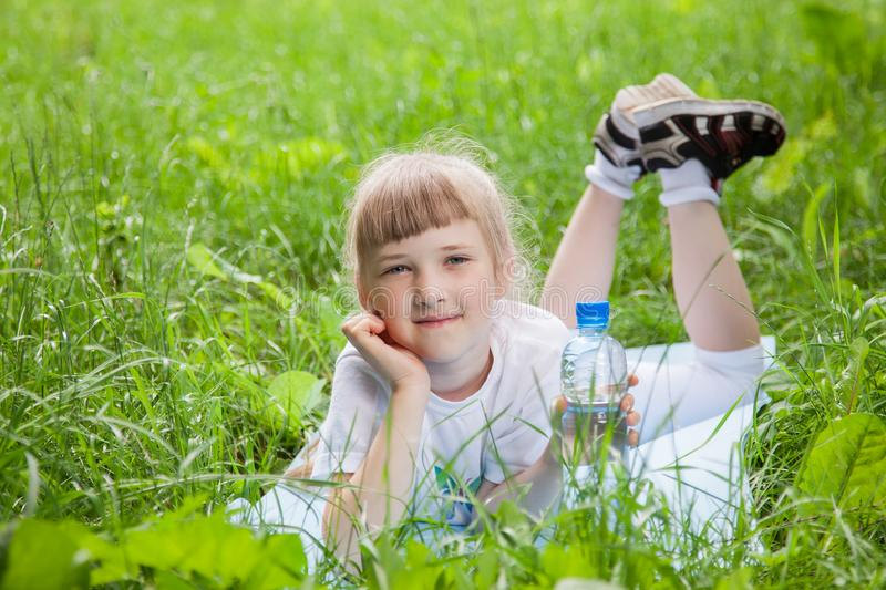 Happy little girl resting in the summer park royalty free stock images