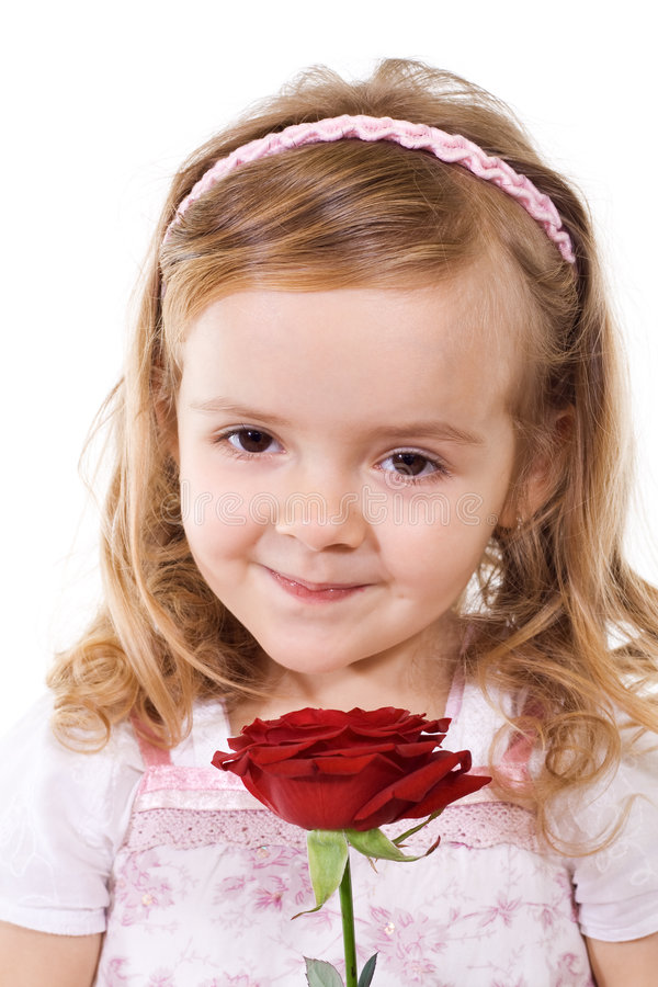 Happy little girl with rose stock photo