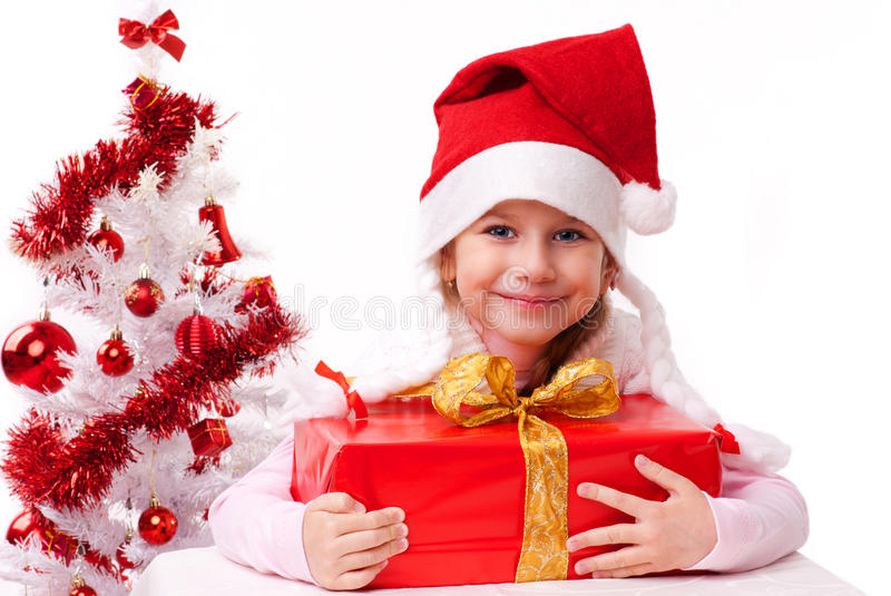 Happy little girl in santa hat royalty free stock photography