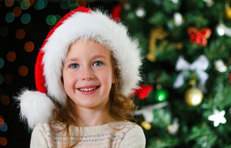 Download Happy Little Girl In Santa's Hat Stock Photo - Image of caucasian, cute: 34655288