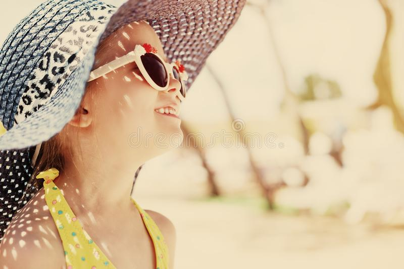 Adorable little girl at beach during summer vacation stock photography