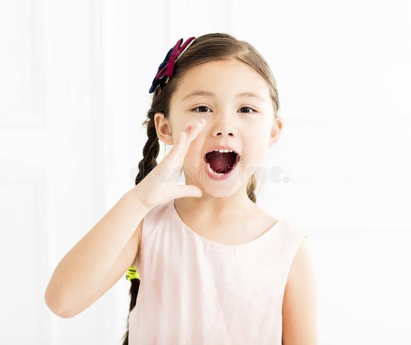 Happy Little girl shouting at home royalty free stock photo