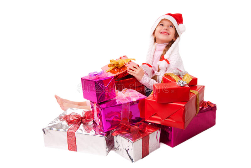 Happy little girl sitting on the gift boxes stock photography