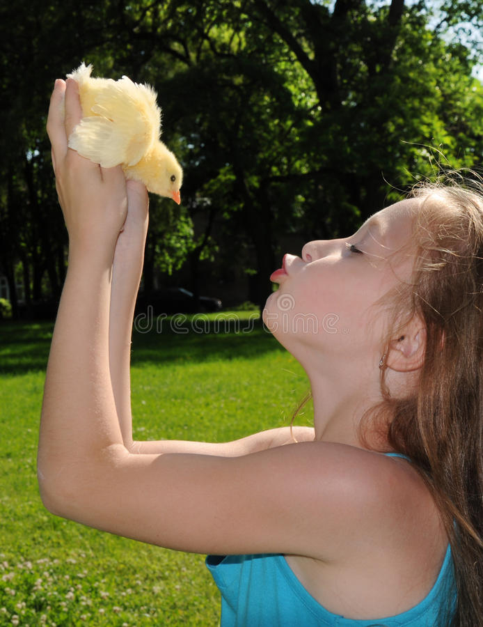 Download Happy Little Girl With A Small Chicken Stock Photo - Image: 23063672