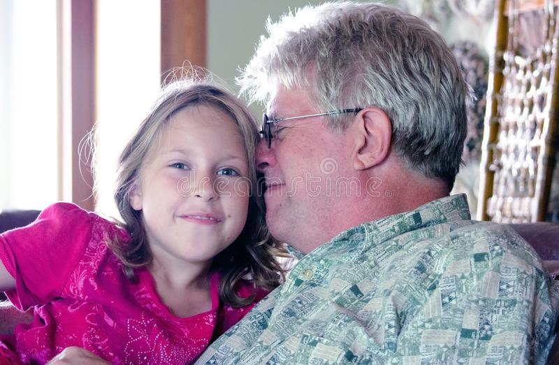 Happy little girl spending time with grandpa royalty free stock image
