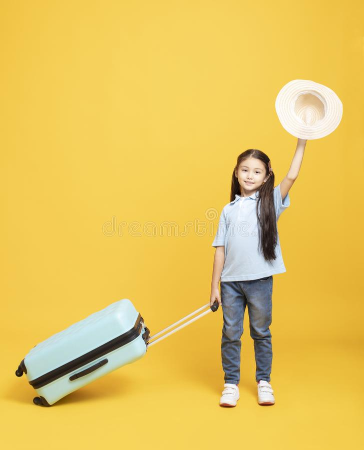 little girl with suitcase going on vacation royalty free stock image